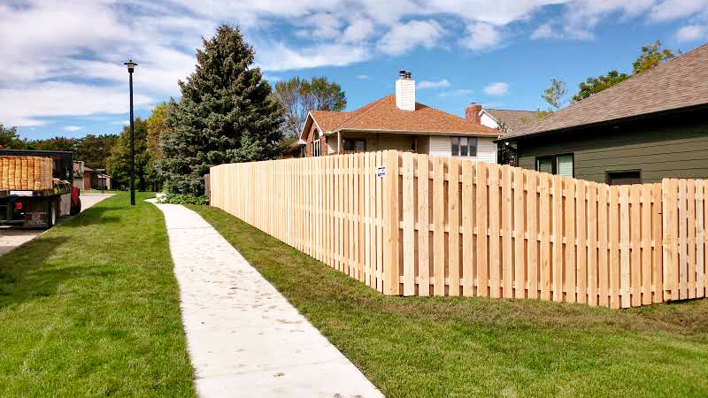 """Wood board-on-board shadow box fence for residential property. Madison fence company fencing contractors Wisconisn cedar western red cedar treated pine white red yellow CCA ACQ2 incense fir 2x4 1x6 2"""" x 4"""" 1"""" x 6"""" nails stain solid privacy picket scalloped board on board shadow box pickets rails posts installation panels post caps modern horizontal backyard front yard ranch gate garden diy split rail house lattice old rustic vertical metal post picket dog ear contemporary custom"""