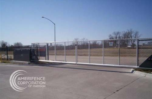 Madison Fence Company automated electric gate opener operators solar motor motorized automatic access control driveway estate slide swing rolling cantilever vertical lift vertical pivot open close stop key pad switch push button three button control intercom call button telephone entry computerized entry loop exit obstruction shadow detector transmitter receiver radio frequency wifi liftmaster linear osco GTO Hy-Security Ty-Metal Doorking box cantilever aluminum - Madison Fence Contractor