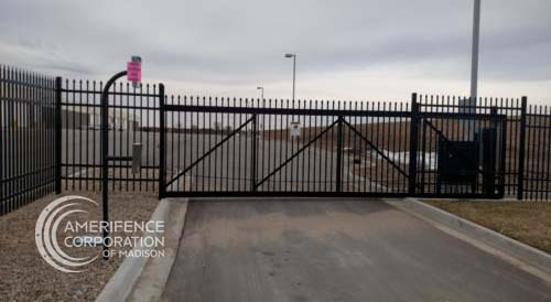 Fence Contractor Madison, WI double single cantilever roller slide vertical lift vertical pivot oramental picket decorative chain link security commercial industrial correctional prison manufacturing hinges hardware swing drive way estate perimeter
